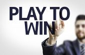 Business man pointing to transparent board with text: Play to Win