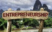 Entrepreneurship wooden sign with a agricultural background