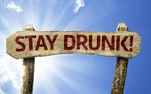 Stay Drunk! wooden sign on a summer day