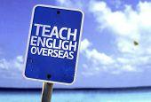 Teach English Overseas sign with a beach on background