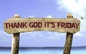 Thank God It's Friday wooden sign with a beach on background