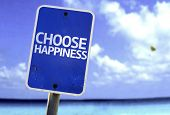 Choose Happiness sign with a beach on background