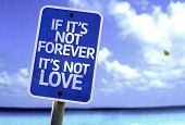 If It's Not Forever It's Not Love sign with a beach on background