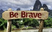 Be Brave sign with a forest background
