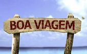 Good Travel (In Portuguese) sign with a beach on background