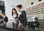 stock photo of motel  - Modern luxury hotel reception counter desk with bell - JPG