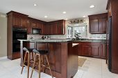 Kitchen with cherry wood cabinetry and center island