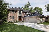 Brick suburban home with three car garage