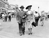 CANADA - CIRCA 1930s: Vintage photo shows married couple walking down the street..