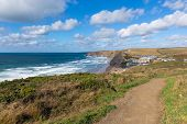 Coast path Watergate Bay Cornwall England UK Cornish north coast near Newquay sunny blue sky day