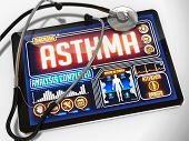stock photo of asthma  - Asthma on the Display of Medical Tablet and a Black Stethoscope on White Background - JPG