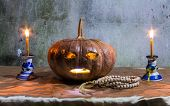 Halloween Still Life With Pumpkins, Candles And Rosary