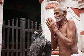 Old Oriyan Priest Praying.