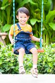 boy playing swing at playground