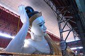Sweet Eye White Reclining Buddha In Myanmar.