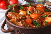 image of stew pot  - stew in tomato sauce with vegetables close up in a pot - JPG