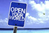 Open your World sign with a beach on background