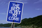 The Best Is Yet to Come sign with a beach on background