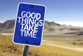 Good Things Take Time sign with a desert background
