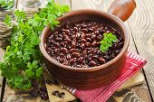 pic of stew  - Bean stew in a ceramic pot on a wooden table - JPG