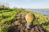 Weathered Spherical Bollard From Close