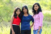 Simple portrait three sisters in outdoor