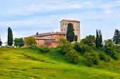Big stone farmer house on the green hill Tuscany Italy