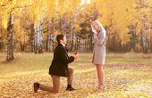 Man Proposing To A Woman In The Autumn Park