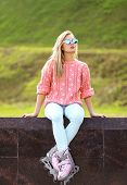 Fashion, Extreme, Fun, Youth And People Concept - Pretty Stylish Blonde Girl In Sunglasses With Roll