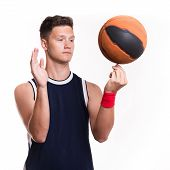 Basketball Player Spins The Ball On His Finger