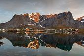 Sunrise In Norway With Reflection
