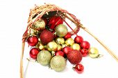 picture of inverted  - Inverted basket of Christmas red and gold balls - JPG