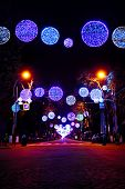 Street decorated with multicolor christmas lights
