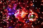 Christmas bell hanging on a christmas tree