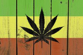 picture of jamaican flag  - Rasta Flag With Marijuana Leaf on wooden background  - JPG