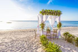 stock photo of cabana  - wedding arch and set up on beach - JPG