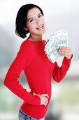 pic of zloty  - Cheerful young lady holding cash  - JPG