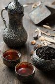 foto of arabic  - Ethnic tea serve on typical arabic tea service on rustic table - JPG