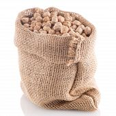 foto of chickpea  - Uncooked chickpeas Uncooked chickpeas on burlap bag on white background - JPG