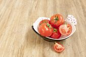 foto of household farm  - bowl of tomatoes on the wooden background - JPG