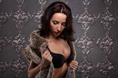 image of seduction  - Sexy brunette woman at black lingerie posing on vintage wall seduction - JPG
