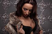 picture of seduction  - Sexy brunette woman at black lingerie posing on vintage wall seduction - JPG