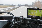 picture of truck-cabin  - View of highway traffic through the windshield of the truck cab - JPG