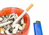 pic of cigarette lighter  - two cigarettes and blue lighter on white background - JPG