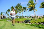 picture of grass area  - Outdoor exercise man running on grass in city park - JPG