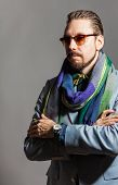 image of bow tie hair  - Fashionable handsome stylish bearded man with sunglasses and in a checkered scarf and bow tie - JPG