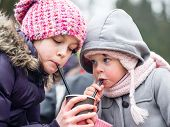 foto of little sister  - cute little sisters drinking water - JPG