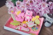picture of biscuits  - on the table colored different figures of biscuits and a bouquet of tulips - JPG