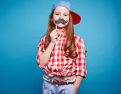 stock photo of moustache  - Charming girl holding moustache on a stick - JPG
