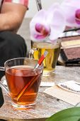 pic of tea bag  - red an green hot tea with tea bags on wood table - JPG